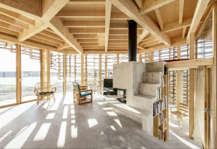 interior living space with wooden beams and concrete flooring