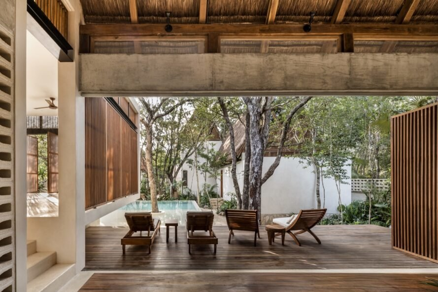 wood chairs on a wood patio by a pool