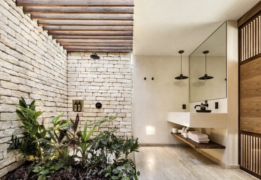 shower enclosed in natural bricks