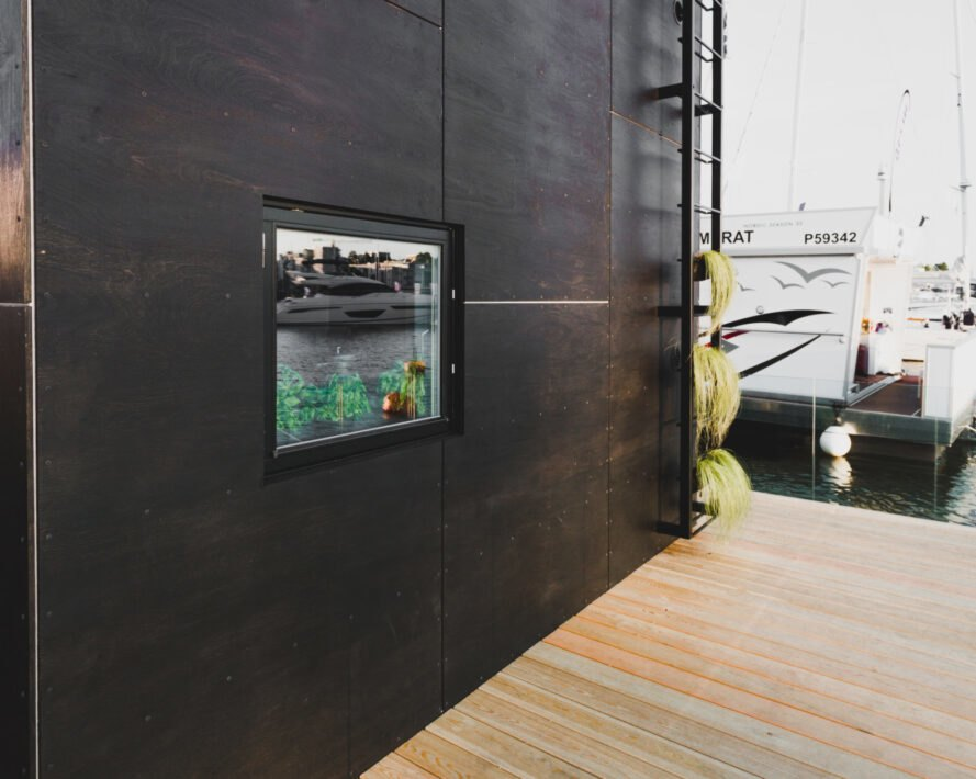 cube-like tiny home set on floating platform