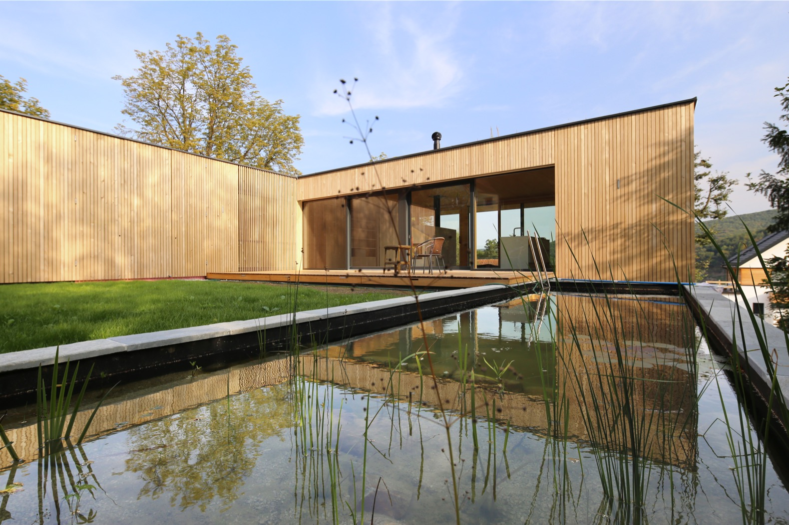 Green-roofed timber dwelling in Austria is built with recycled materials