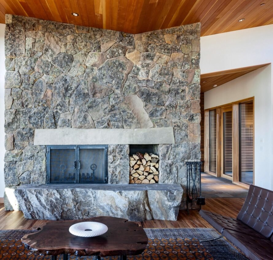 fireplace lined with exposed rock and marble