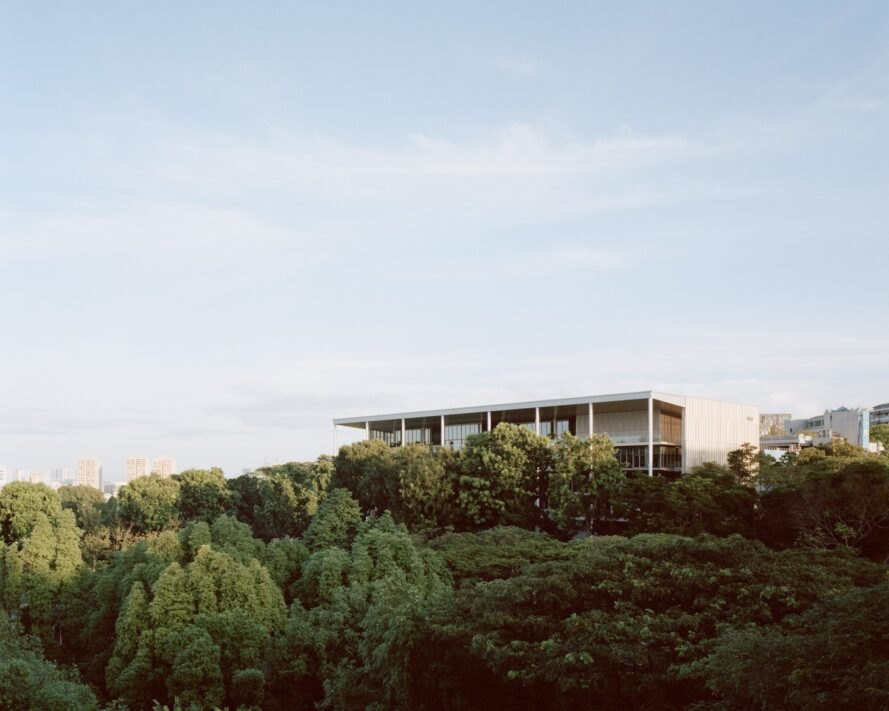 SDE4 sits atop a hill of greenery surrounded by trees