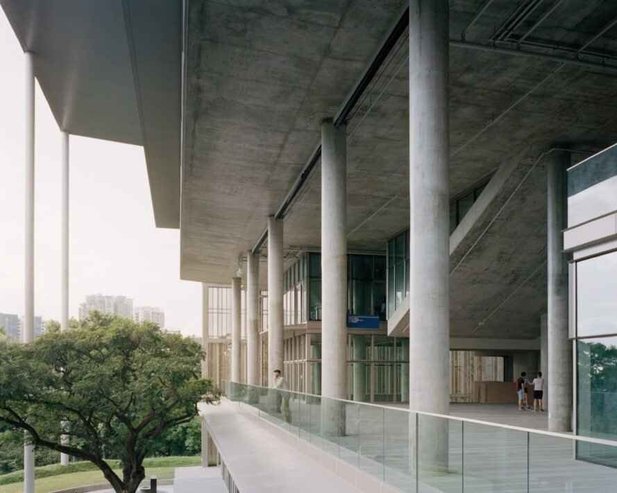 exterior view of the building with pillars and high ceilings
