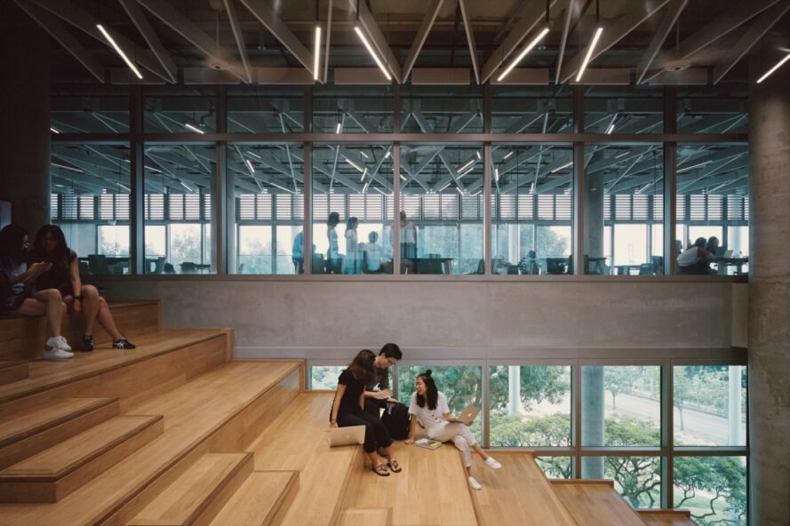 students sit on wood stairs
