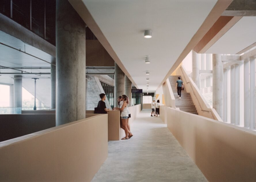 interior of building with students walking through hallways and stairwells