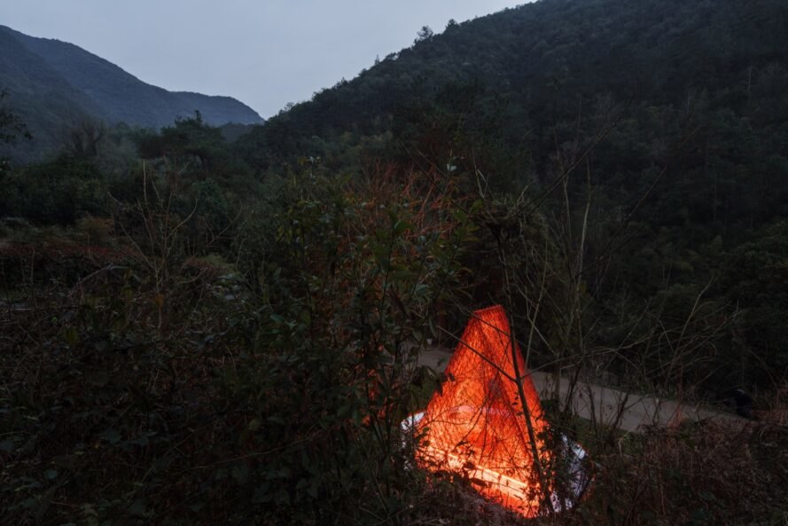 red triangular pavilion facing mountains