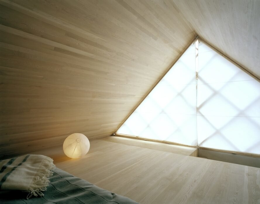 interior bedroom area with geometrical designed windows and walls