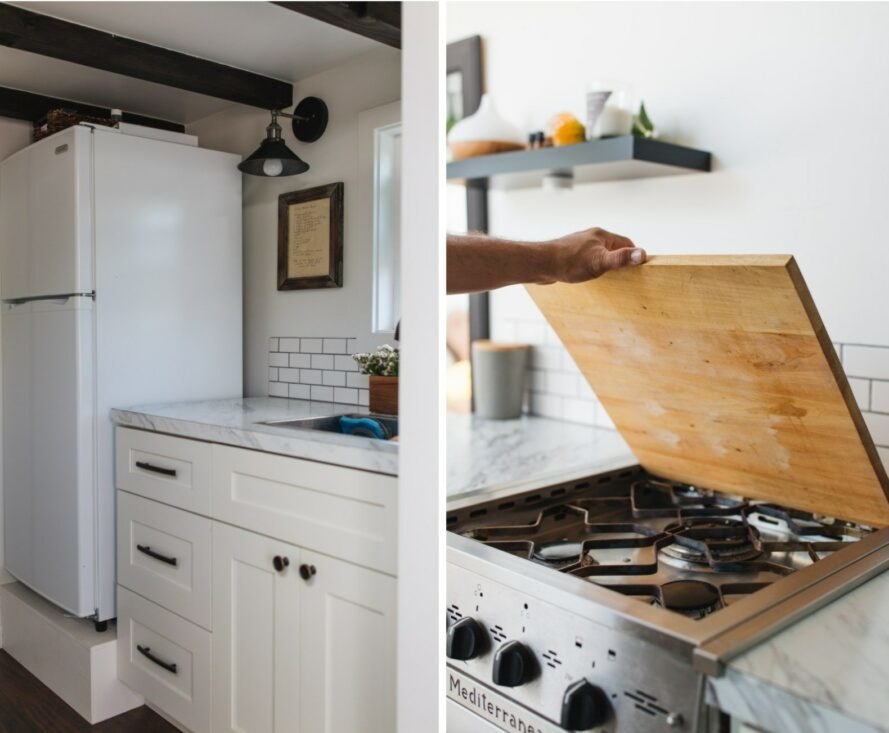 white kitchen with stovetop burners under a wooden cover