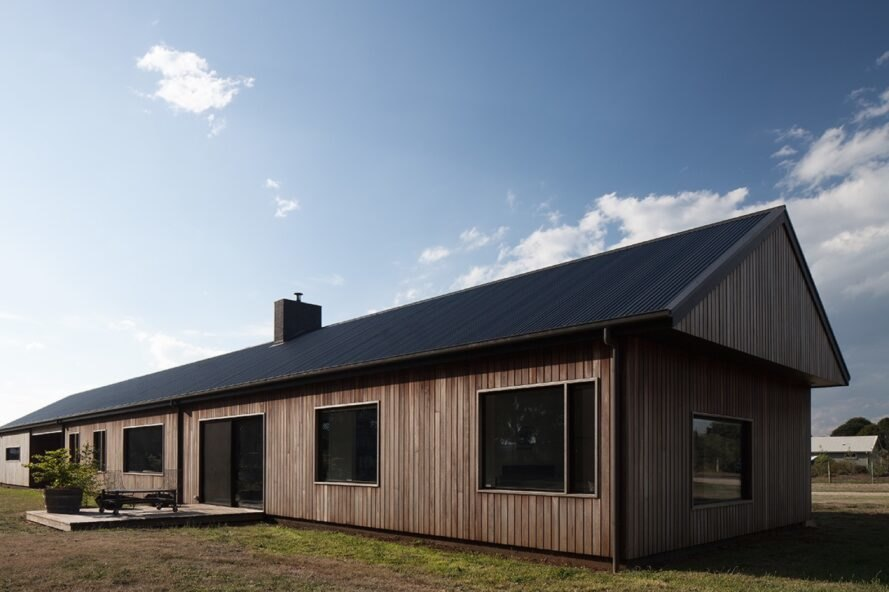 timber modern farmhouse with gabled roof