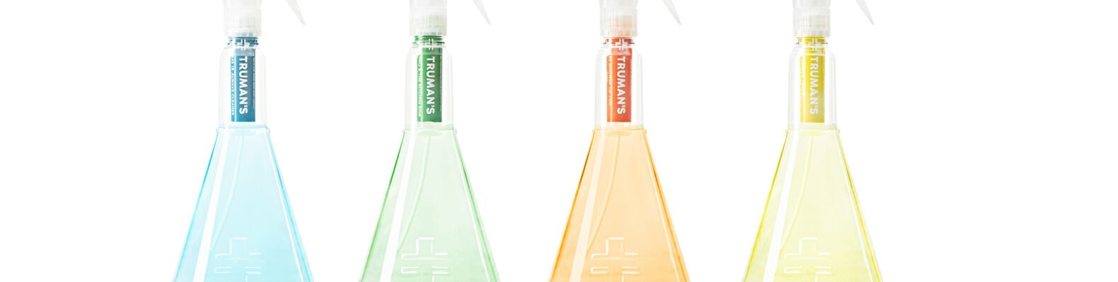 four spray bottles with different colors of cleaning solution cartridge