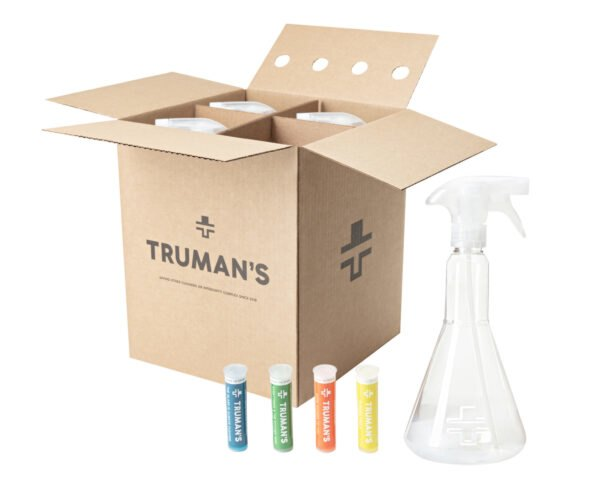 cardboard box with plastic spray bottles and colorful cleaning cartridge refills