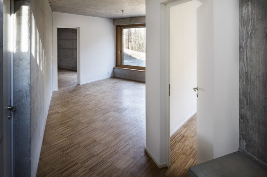 interior of home with white walls and timber floors
