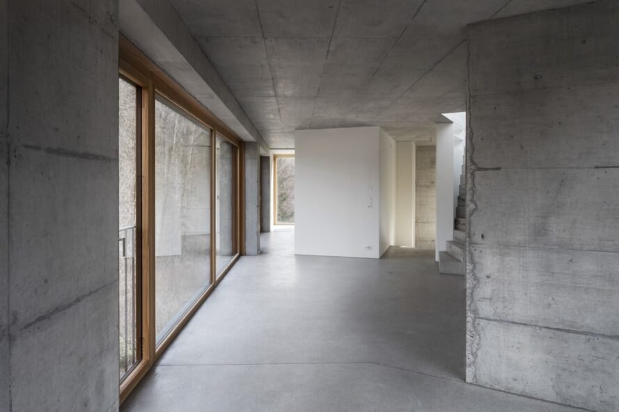 interior of home with concrete walls and large windows