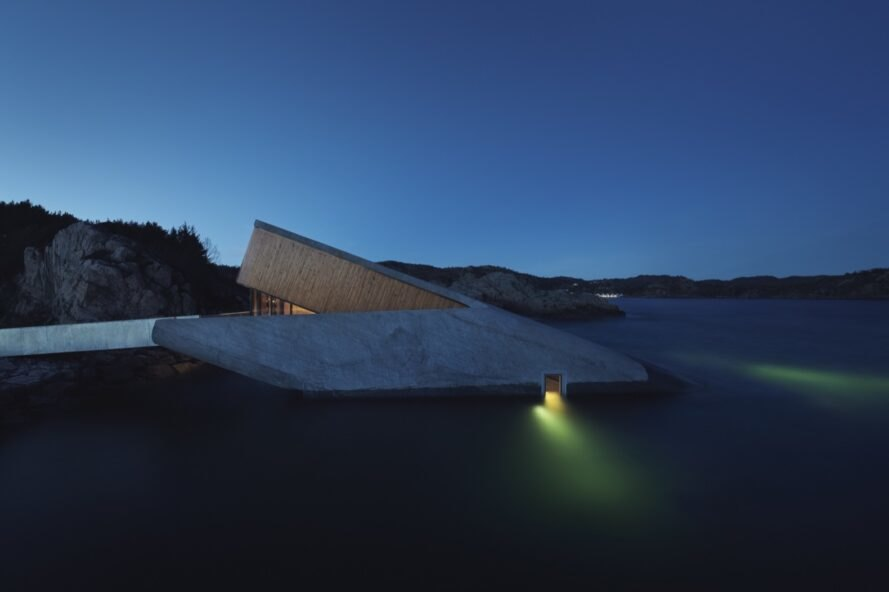 gray underwater restaurant with one beam of light glowing at night