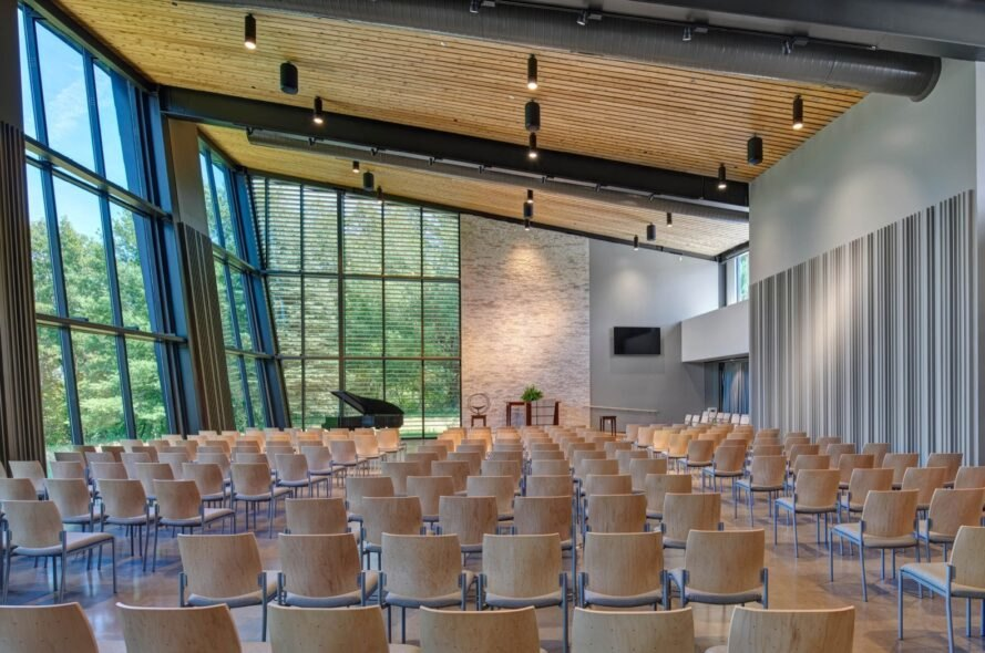 auditorium with wood ceilings and several wood chairs