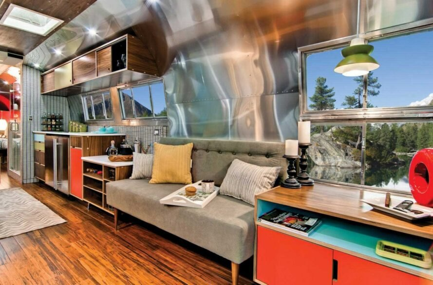 Airstream interior with aluminum walls and a gray sofa