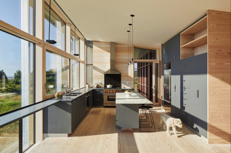 kitchen space with gray cabinets and wooden flooring