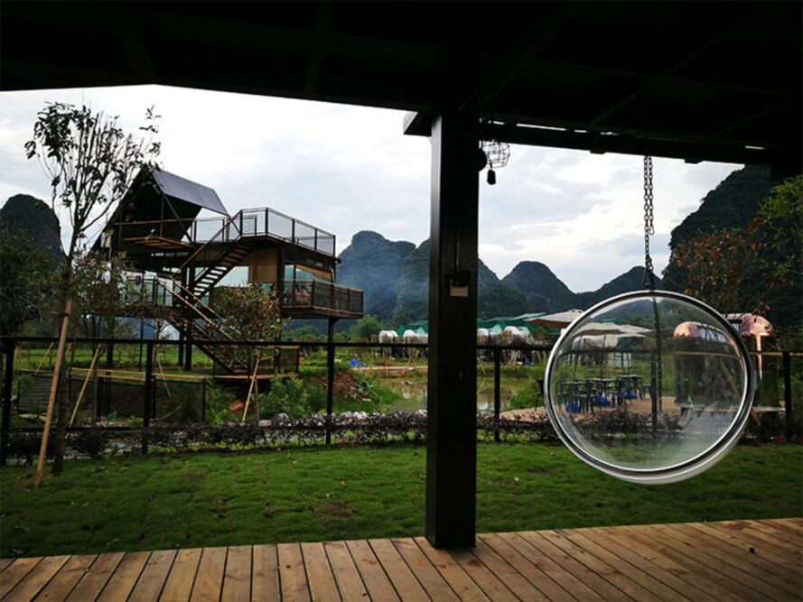 outdoor area with swinging bubble chair