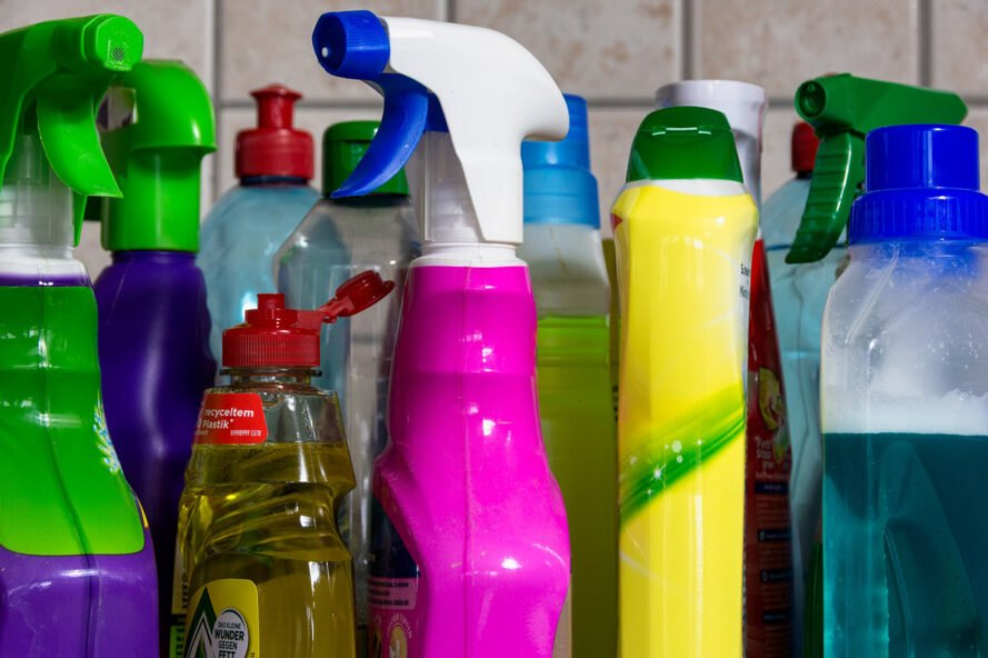 colorful plastic cleaning products on a counter