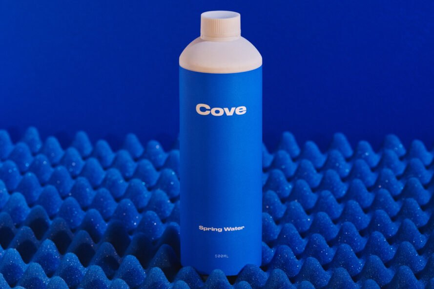 biodegradable water bottle on blue background