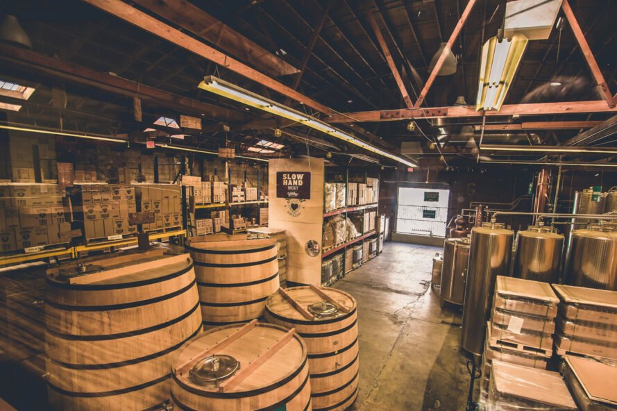 large production room with whiskey barrels