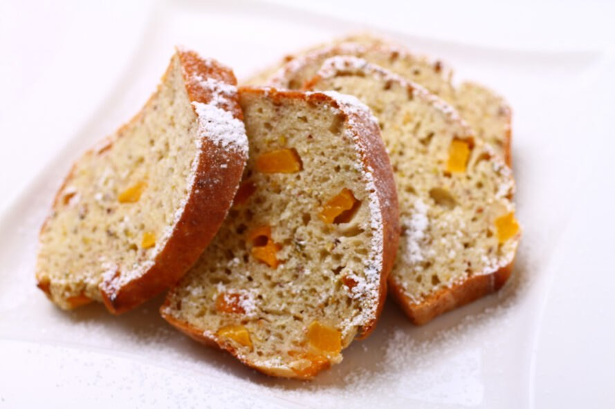 slices of fruit bread on white background