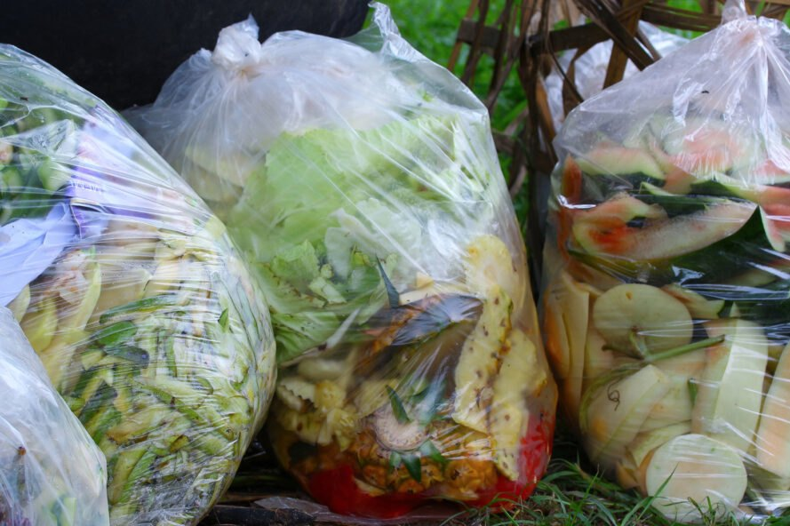 trashbags filled with produce