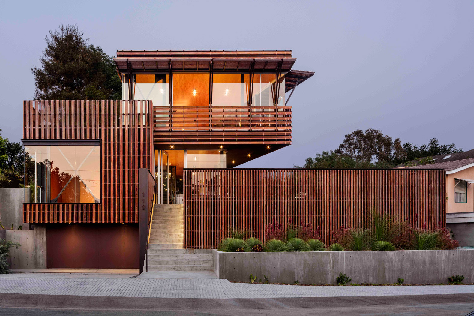 Santa Barbara home is surrounded by wooden screens for natural climate control