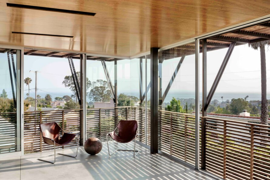 room with glass walls and two chairs