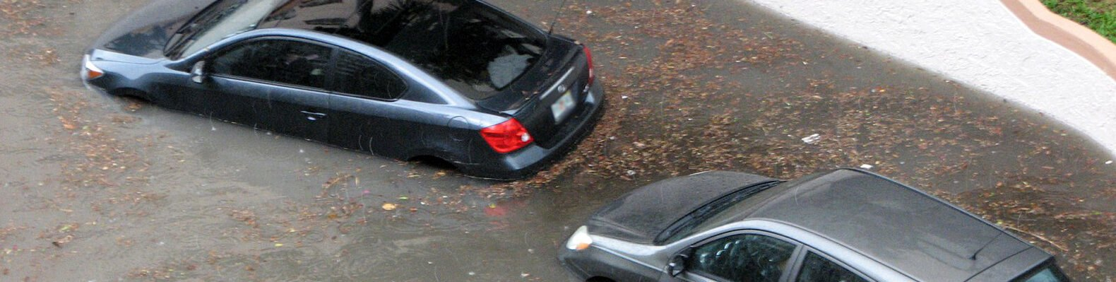 two cars in flooded waters