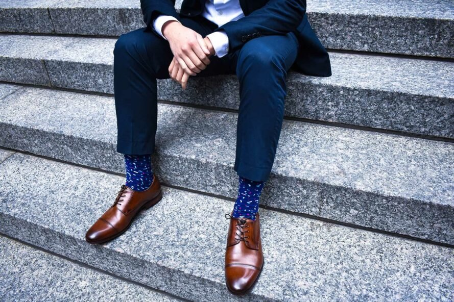 man in a suit with blue socks and colorful sprinkle