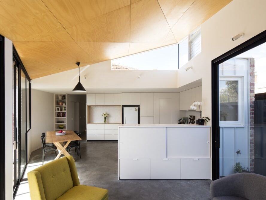 light fills the dining and kitchen area with large windows and a hardwood ceiling