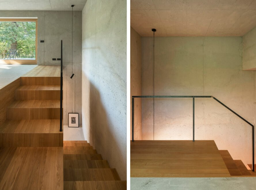 wood staircase inside home with metal railing