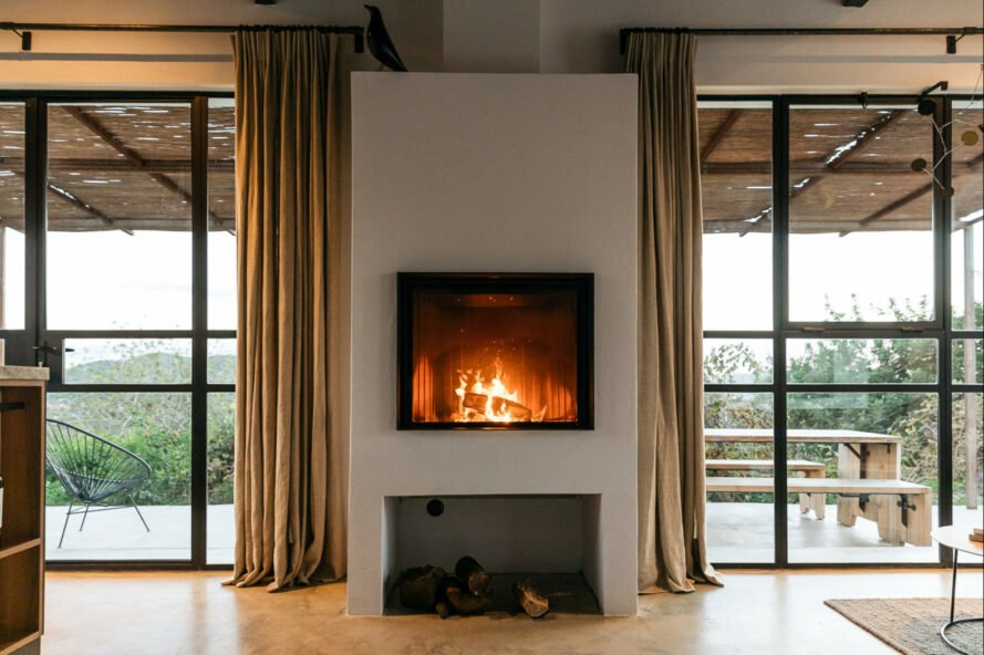 fireplace with two large windows on either side