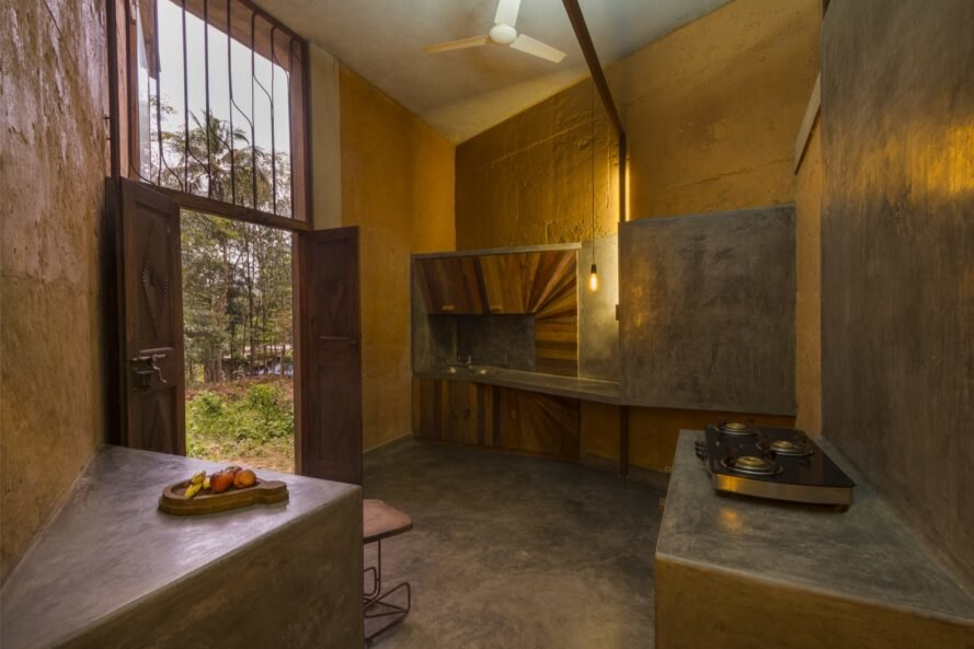 kitchen in room with mud walls