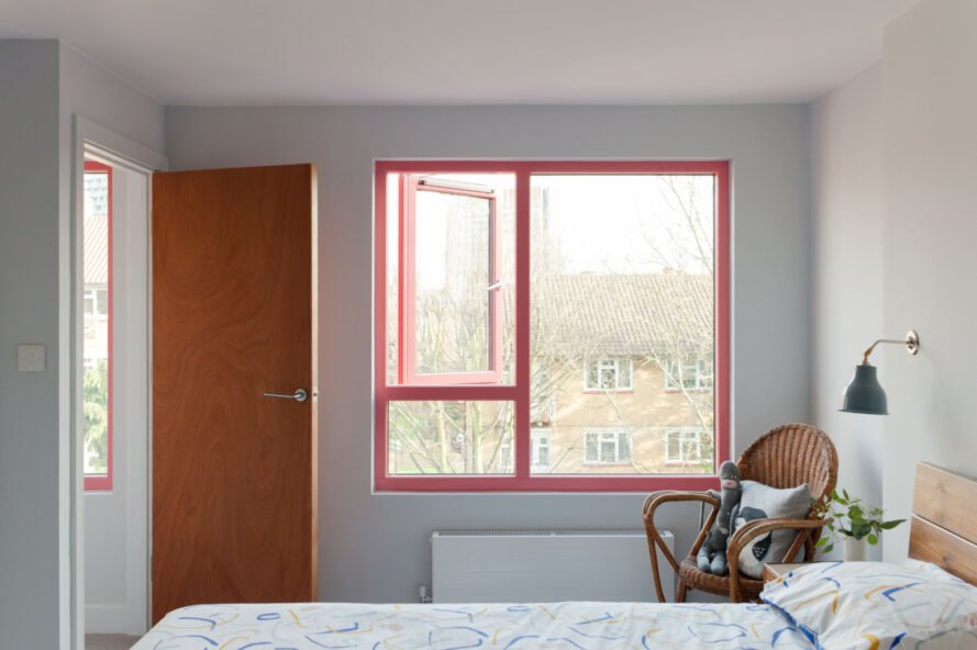 bedroom with large window framed in red