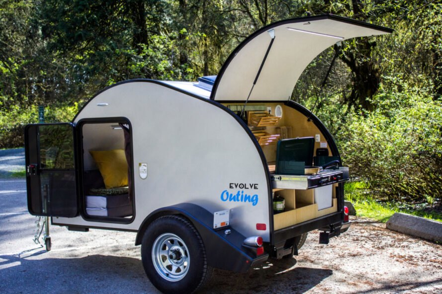 white teardrop camper with back door lifted open