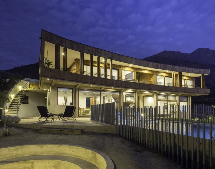 curved wooden home lit up at night