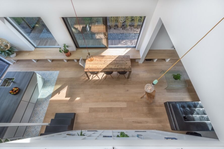 wood dining table with wood floors positioned near a window