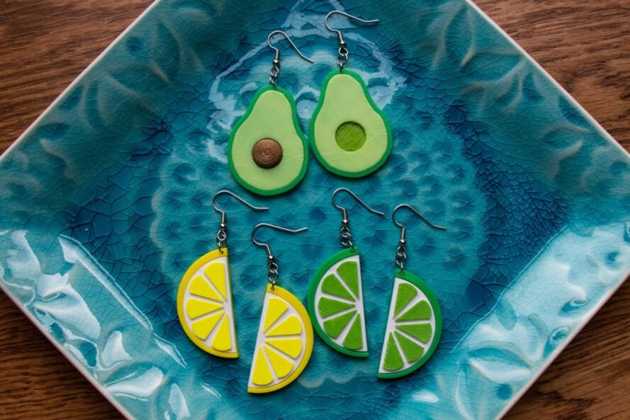 a bowl with avocado and lemon and lime earrings