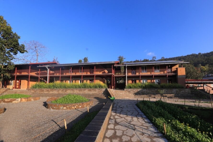 courtyards outside rammed earth school buildings