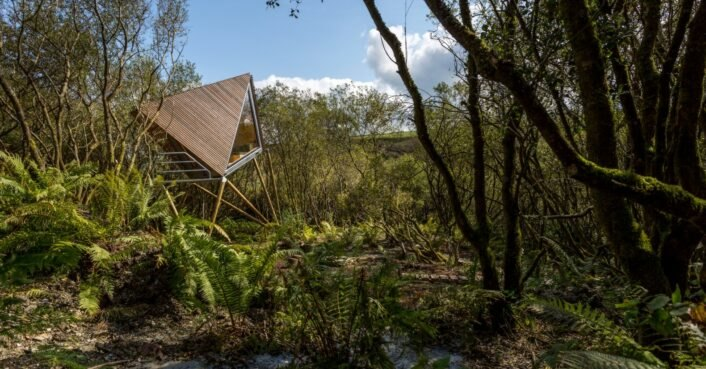photo of A series of tiny, geometric cabins in an overgrown slate quarry are a truly secluded retreat image