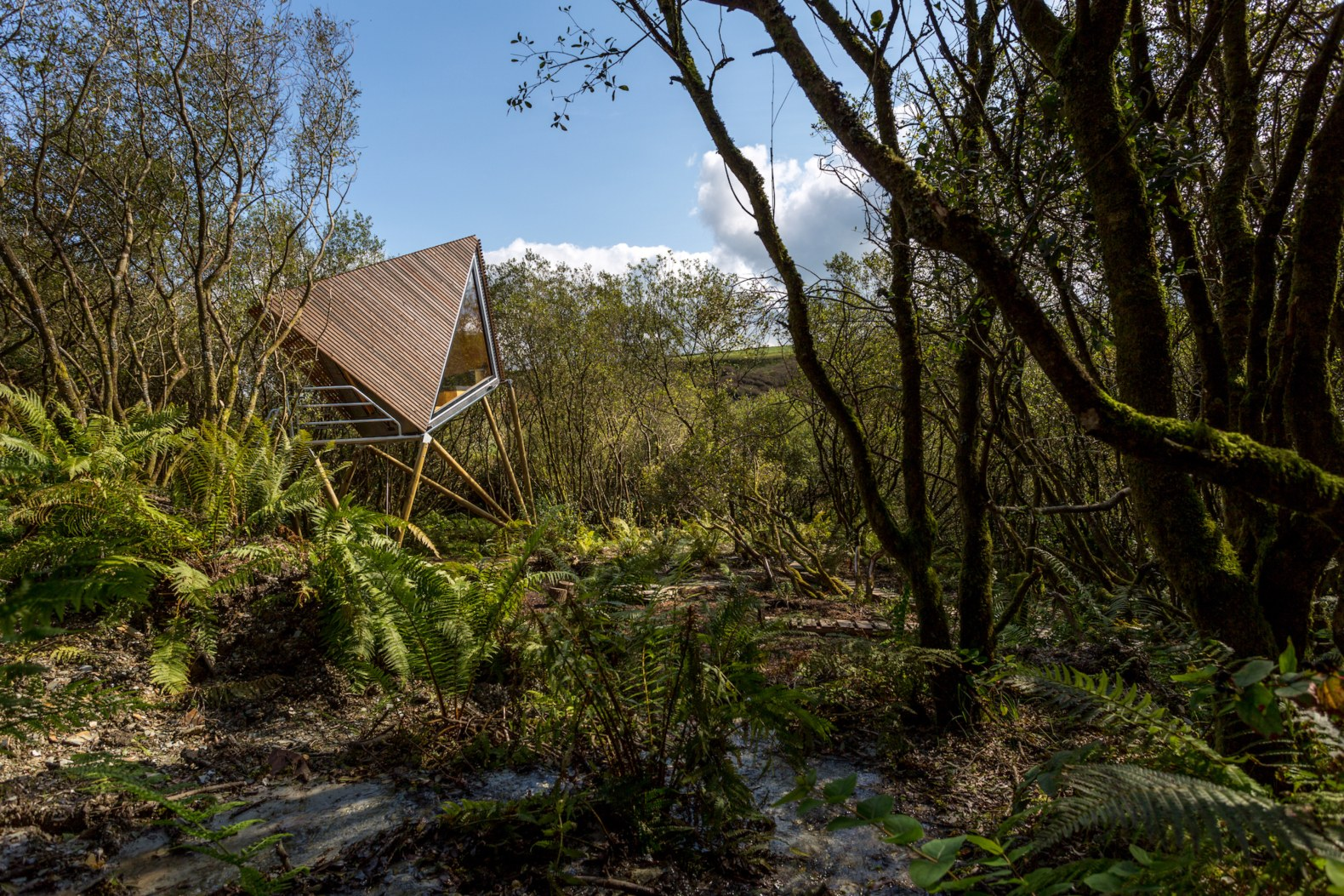 A series of tiny, geometric cabins in an overgrown slate quarry are a truly secluded retreat