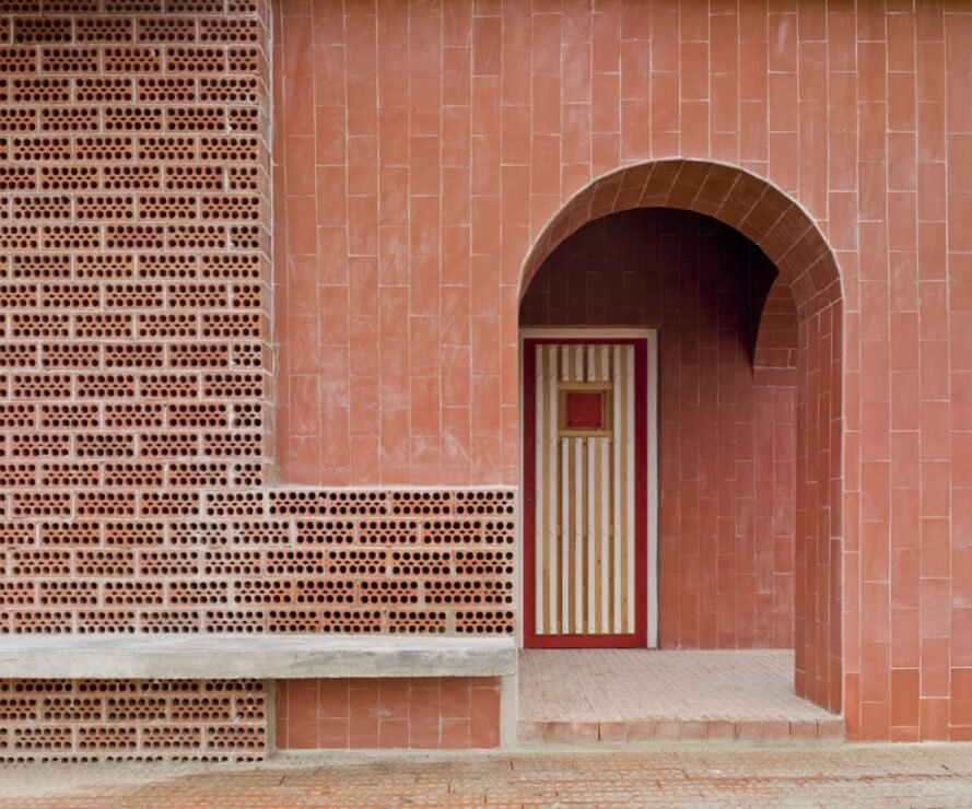 rounded doorway to a brick home