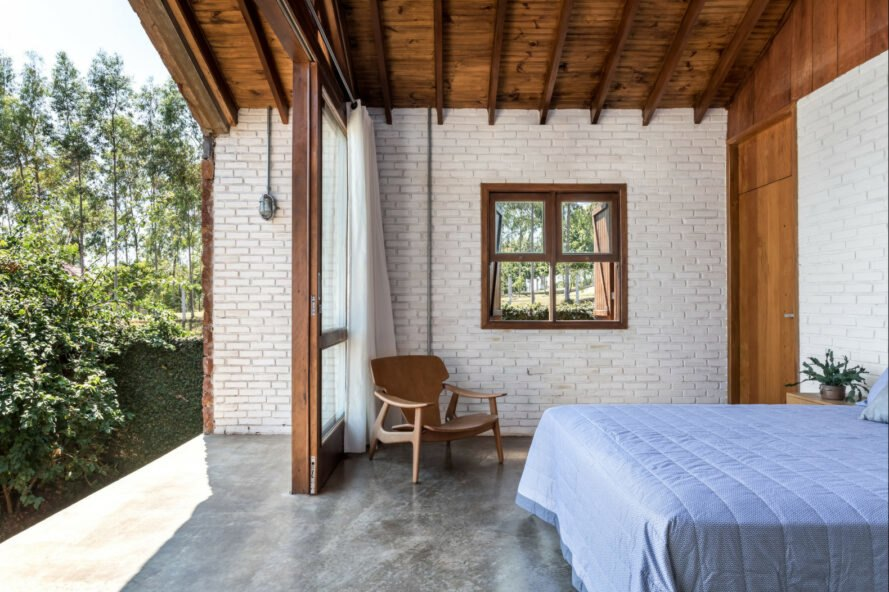 bedroom with brick walls and outdoor deck