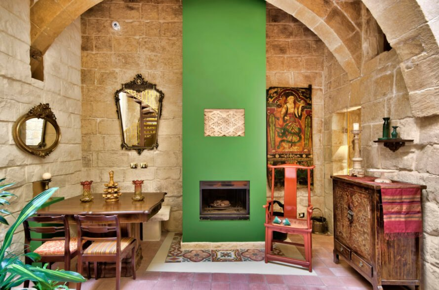 stone room with green fireplace and mantel