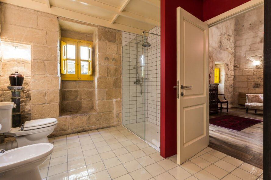 large bathroom with stone wals