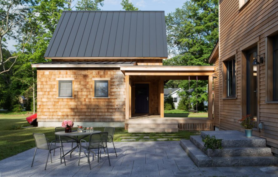 patio near a wood garage with pitched roof