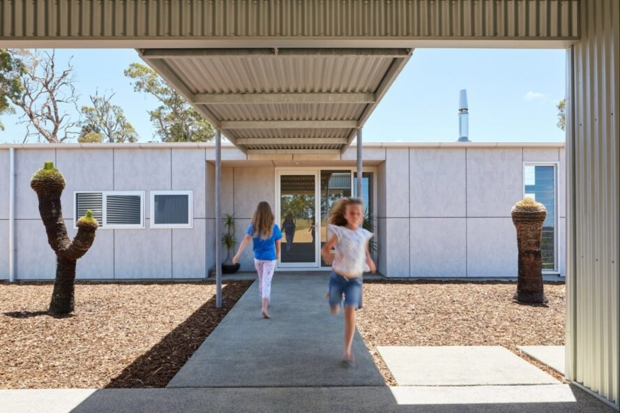 children running through a covered exterior walkway